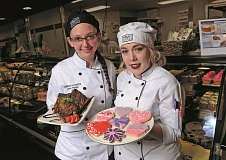 PAMPLIN MEDIA GROUP PHOTOS: VERN UYETAKE - Chef Laura Bliss, left, and Bakery Manager Kaylin Schimpf  show off just a few of the delectable treats available at Market of Choice.