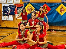 COURTESY OF SETH JOHNSON - Woodstock students dance at Chinese New Year Celebration in the school gym.