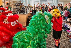 DAVID F. ASHTON - Lucky New Year Lions, led by the boy Buddha, begin the Lunar New Year celebration at the Woodstock Branch Library.