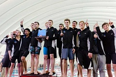 HILLSBORO TRIBUNE PHOTO: CHASE ALLGOOD - The Hilhi Spartans celebrate the first state swim championship in school history, Feb. 18 at Mt. Hood Community College.