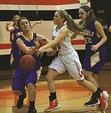 PHOTO COURTESY OF CHRISTINA CONROY  - Molalla junior Sierra Cox dribbles past a Crook County defender during the Indians' 59-27 win over Crook County last Tuesday.