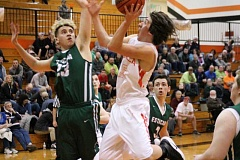 PIONEER PHOTO: CONNER WILLIAMS  - Molalla junior Marcus Simpson goes in for a layup during the Indians' 51-36 loss on senior night last Friday.