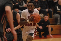 GRESHAM OUTLOOK: MATT RAWLINGS - Moses Kinga drives the ball to the hoop in traffic