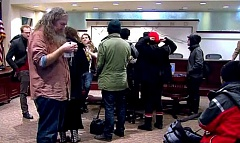 COURTESY PHOTO: KOIN 6 NEWS FACEBOOK LIVE - About two dozen protesters took over Portland's City Council chambers Wednesday morning, Feb. 22, chanting and shouting as city commissioners walked out of the meeting. The group talked about needing assistance for homeless people.