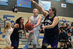 REVIEW PHOTO: MILES VANCE - Lakeridge's Sierra Zevenbergen goes to the basket during her team's 67-34 home loss on Tuesday.