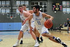 REVIEW PHOTO: MILES VANCE - Lakeridge senior Ian Gaekwad drives the baseline during his team's 77-70 win over Canby on Tuesday night.