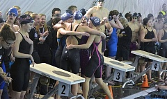 TIMES PHOTO: MATT SINGLEDECKER - The Sunset girls swimming team's 400-yard freestyle relay celebrates its win over Jesuit at the Class 6A state championship meet.