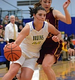 OUTLOOK PHOTO: DAVID BALL - Barlows Diana Gotur cuts in front of Central defender Kellis Deck for a layup during the Bruins 59-51 loss Tuesday.