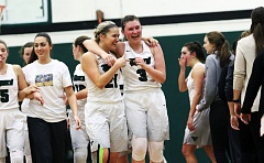 DAN BROOD - Members of the Tigard High School girls basketball team, including Kylie Warren (21) and Campbell Gray (3), are all smiles following the 50-35 win over Lake Oswego.
