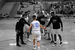 REVIEW PHOTO ILLUSTRATION: MILES VANCE - Lakeridge senior Jimmy Li -normally the team's manager - took his turn in the spotlight on Tuesday, joining the team on court to celebrate four years of being cancer-free after previously diagnosed with a brain tumor.
