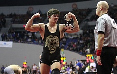 TIDINGS PHOTO: MILES VANCE - West Linn's Taran Floyd flexes his muscles after beating Mitchell Sorte of West Albany 6-3 in their semifinal at 160 pounds at the Class 6A state wrestling tournament on Saturday.