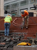 PAMPLIN MEDIA GROUP: JOSEPH GALLIVAN - Workers from Performance Abatement Services remove bricks from Pioneer Courthouse Square in preparation for a new waterproof membrane after the old one failed and water leaked into offices below.