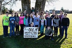 SUBMITTED PHOTO - Out of a class of 30 fifth graders at John McLoughlin Elementary School, most received parental consent to submit letters to the editor, including, front row Mira Jansen (holding sign) and Elias Trusty. Second row: Malachi Wilson, Billy Wharton, Hana Goben, Isabelle Ness, Addelinn Welch, Skyler Helzer, Kaitlen Carns, Grace Neubert, Elijah Rising, Samantha Marsh, Quentin Hopp Back Row: Tailee Martin, Aryn Burkhardt, Derek Baker, Angela Saltenberger, Grant Suski, Tate Flowers, Michele Young Tree: Ahren Peterson. Not Pictured: Anthony Hicks, Finton McGuire, Aramae Morales, Jack Nelson