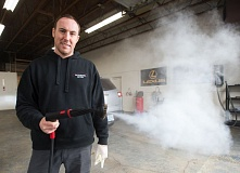 OUTLOOK PHOTO: JOSH KULLA - Steam cleaning allows Phil D'Avanzo to save more than 70 gallons of water per vehicle over traditional pressure washing.