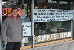 REVIEW PHOTO: ANTHONY MACUK - Lake Oswego business owner Kevin Kerwin stands outside his downtown computer repair shop, where a sign in the window advertises a 'March 4 Trump' rally planned for March 4. Kerwin has a history of posting signs in the window of his store that convey provocative messages with anti-liberal themes.