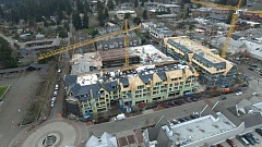 PAMPLIN MEDIA GROUP: ALVARO FONTAN - Construction led the way in the past 12 months by adding thousands of jobs as Oregon's unemployment rate for January hit a record low. This project in downtown Lake Oswego is one of the region's largest construction sites.