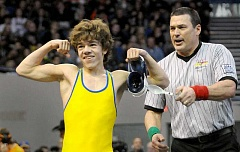 SETH GORDON - Cody Fettig celebrates his state championship at 106 pounds in the Class 6A tournament Saturday at Memorial Coliseum in Portland.
