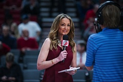 TRIBUNE PHOTO: JOHN LARIVIERE - Life took a tragic turn in 2011 for budding broadcaster Brooke Olzendam, but she overcame it and has settled into a job the Trail Blazers created for her.