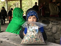 PAMPLIN MEDIA GROUP: JENNIFER ANDERSON - Duncan Anderson, 8, son of reporter Jennifer Anderson, holds up a bag of plastic debris collected on an Oregon beach by volunteers with Sea Turtles Forever.