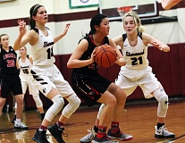 DAN BROOD - Sherwood sophomore Alex Verkamp (left) and junior Lauren Scarvie put pressure on Lincoln's Kate Nichols late in Wednesday's playoff game.