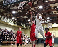 TIDINGS PHOTO: MILES VANCE - West Linn's Rodney Hounshell goes up to score during his team's 76-65 win over Lincoln in the second round of the Class 6A state playoffs on Friday at West Linn High School.