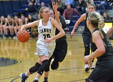 PMG PHOTO: COREY BUCHANAN - Canby's Mackenzie Lee and the Cougars will try to win their way into the Class 6A state tournament when they play at Oregon City at 7 p.m. tonight.