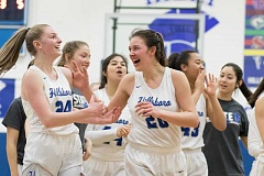 HILLSBORO TRIBUNE PHOTO: CHASE ALLGOOD - Hillsboro's Makenna Gambee and Kendra Wilson celebrate their state playoff win over Churchill, March 4.