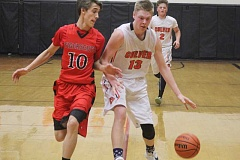 WILL DENNER/MADRAS PIONEER - Mike Davis (13) earned second-team CBC honors after averaging 10.9 points and 10 rebounds per game this season.