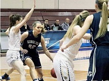 PHOTO COURTESY OF GFU - George Fox wing Tavin Headings dribbles into the lane Friday night during George Fox's 76-72 loss to Whitman in the opening round of the NCAA Division III women's basketball tournament.