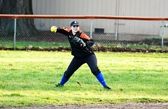 SPOTLIGHT PHOTO: JAKE MCNEAL - Indians senior second base Nicole Lukinbeal makes a cut-off throw in tryouts on Monday at Otto Petersen Elementary in Scappoose.