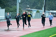 SPOTLIGHT PHOTO: JAKE MCNEAL - From left, Lions sophomores Kaitlyn Silva, Lei Jacob and Isabelle Mendoza, junior Emelia Reardon, senior Nina Hansen and freshman Anessa Mandella dash down the main stretch at practice on Tuesday at Doc Ackerson Stadium in St. Helens.