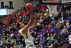 TIDINGS PHOTO: MILES VANCE - West Linn senior Khalid Thomas scores during the second quarter of his team's 89-59 win over North Medford in the quarterfinals of the Class 6A state tournament on Wednesday at the Chiles Center.