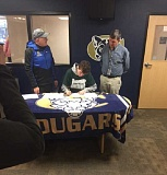 SUBMITTED PHOTO: MARK MARTENS - Canby runner Neal Cranston signs his letter of intent in February.