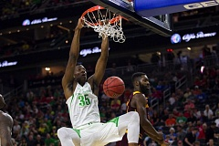 COURTESY: JOSH ORCUTT/THE STATE PRESS - Oregon junior foward Kavell Bigby-Williams dunks during the first half of Thursday's Pac-12 quarterfinal victory over Arizona State.