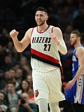 TRIBUNE PHOTO: JOSH KULLA - Blazers center Josh Kulla celebrates as Portland holds off the Philadelphia 76ers in overtime Thursday night at Moda Center.