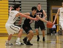 REVIEW/NEWS PHOTO: JIM BESEDA - Gladstone's Damian Zaines scored a game-high 20 points on the bench, leading the Gladiators to a 61-59 come-from-behind win over Philomath Friday at Forest Grove High School.