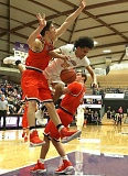 TRIBUNE PHOTO: JAIME VALDEZ - A collision under the basket involves Jefferson's Geno West (center) and two Beaverton players during Friday's Class 6A semifinal at Chiles Center.
