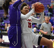 PAMPLIN MEDIA: DAVID BALL - Clackamas High sophomore Kalani Hayes fights her way to the basket against Sunsets Rose Pflug during the Apollos 45-33 consolation win Friday.