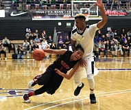 PAMPLIN MEDIA: MILES VANCE - Elijah Gonzales drives past Rodney Hounsell in Clackamas's 78-71 win over West Linn