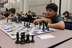TRIBUNE PHOTO: LYNDSEY HEWITT - Carlito Bryant Garcia, 11, of Lake Oswego's Westridge Elementary, likes that you can make chess 'your own game' depending on your strategy.