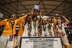 TRIBUNE PHOTO: JONATHAN HOUSE - The Jefferson Democrats hoist their state championship trophy Saturday at Chiles Center.