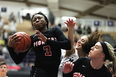 PAMPLIN MEDIA: JAIME VALDEZ - Oregon City senior N'Dea Flye controls the ball under the basket duirng Saturday night's OSAA Class 6A girls' basketball championship final against Southridge at the Chiles Center.