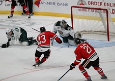 COURTESY: AL SERMENO/PORTLAND WINTERHAWKS - Portland Winterhawks forward Skyler McKenzie fires a shot on Everett netminder Carter Hart on Sunday at the Moda Center.