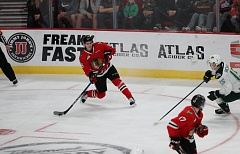 COURTESY: AL SERMENO/PORTLAND WINTERHAWKS - Portland Winterhawks defenseman Henri Jokiharju snaps a pass to a teammate in a game against the Everett Silvertips Sunday at Moda Center.