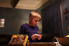 TIMES PHOTO: JAIME VALDEZ - Desmond Zirkelbach, an autistic student at Charles F. Tigard Elementary School, plays with Legos at home. Desmond is the namesake of 'I Run for Desmond,' a 5K and fun run to raise money for special education at his school.