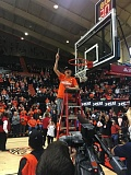 TRIBUNE PHOTO: KERRY EGGERS - Oregon State guard Sydney Wiese cuts down the net after the Beavers clinched the Pac-12 regular-season championship at Gill Coliseum.