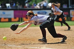 PAMPLIN MEDIA PHOTO - Glencoe senior Sydney Sahlfeld reaches for a ground ball during last season's state championship game versus Jesuit.