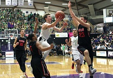 TIDINGS PHOTO: MILES VANCE - West Linn senior guard Braden Olsen (here against Clackamas in the 2017 Class 6A state tournament) was named to the all-Three Rivers League first team after leading the Lions to a TRL title and the state in assists.