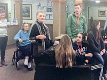 CONTRIBUTED PHOTO: KRISTOLE JUKER - Students in Estacada Middle Schools service learning class listen as Jeanne Flohr shares a story. The students visit Grace Place each Thursday.