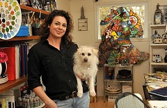 STAFF PHOTO: VERN UYETAKE - Artist Alyson Whitney, shown here with her dog, Tater Tot, helps people celebrate their pets lives with custom urns, wall hangings and textiles.